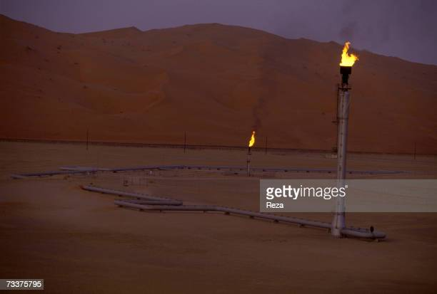 Flare stacks burn at the Saudi Aramco oil field complex facilities at Shaybah in the Rub' al Khali desert on March 2003 in Shaybah Saudi Arabia