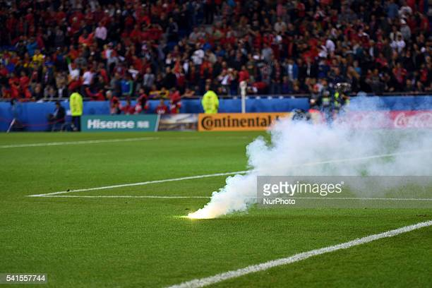 Flare thrown onto the pitch by romanian fans during the UEFA Euro 2016 Group A match between Romania and Albania at Stade de Lyon in Lyon France on...