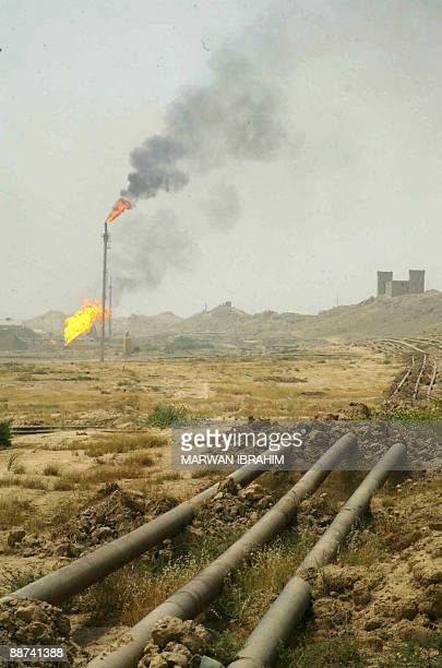 Flared gas burns at the Bai Hassan oil field some 40kms north of the city of Kirkuk on June 29 2009 Iraq tomorrow will unveil which foreign firms...