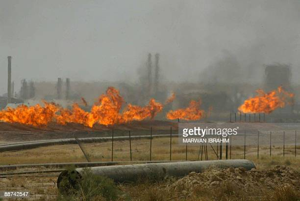 Flared gas burns at the Kirkuk oil field on June 29 225 kms from the capital Baghdad Iraq will unveil on June 30th which foreign firms have won...