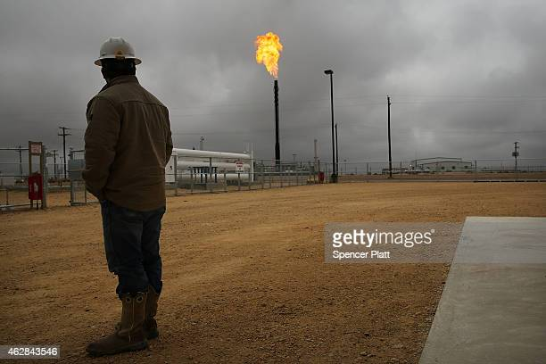Flared natural gas is burned off at Apache Corporations operations at the Deadwood natural gas plant in the Permian Basin on February 5 2015 in...
