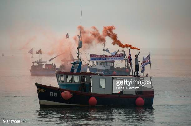 Flares are fired from the deck of fishing boats as a flotilla of boats head out of Whitstable harbour as fishermen take part in a nationwide protest...