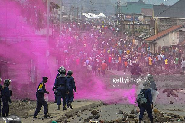 TOPSHOT Flares are launched by DRCongo Police forces during a demonstration in Goma on September 19 2016 At least 17 people mostly civilians were...