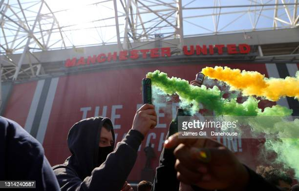 Flares are let off around Old Trafford as Manchester United supporters protest against the Glazer ownership during a protest against the club's...