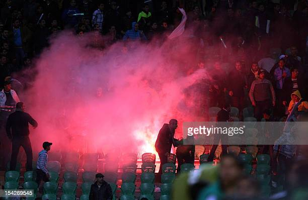 Flares are thrown in the stadium during clashes that erupted after a football match between Egypt's AlAhly and AlMasry teams in Port Said 220 kms...