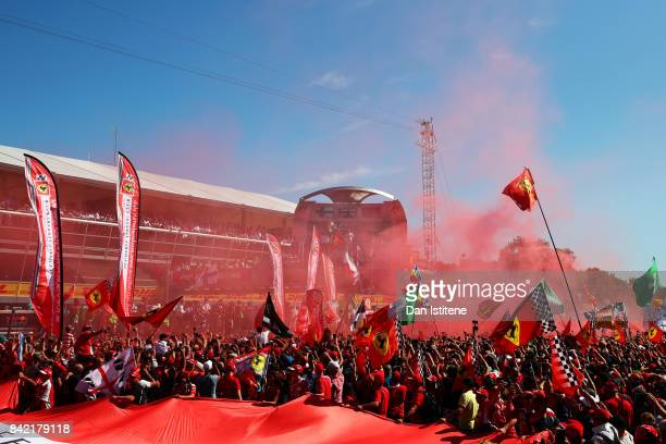 Flares go off in the crowd at the podium celebrations during the Formula One Grand Prix of Italy at Autodromo di Monza on September 3 2017 in Monza...