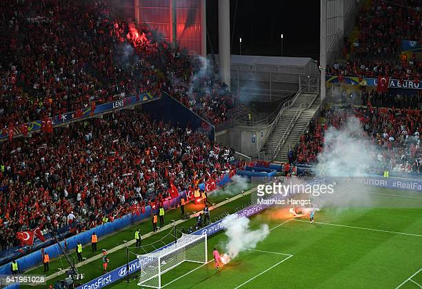 Flares on the pitch during the UEFA EURO 2016 Group D match between Czech Republic and Turkey at Stade BollaertDelelis on June 21 2016 in Lens France
