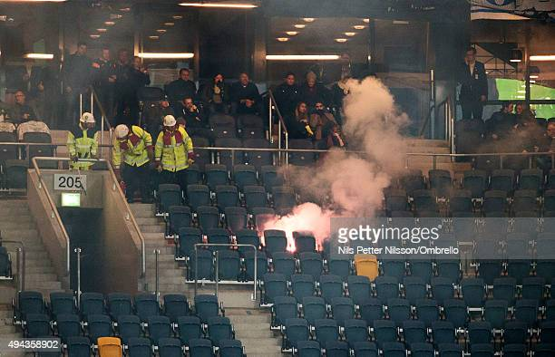 Flares thrown from the IFK Goteborg fans during the Allsvenskan match between AIK and IFK Goteborg at the Friends arena on October 26 2015 in Solna...