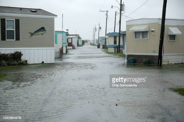 Flash flooding covers the road in lowlying areas as the outer edges of Hurricane Florence being to affect the coast September 13 2018 in Atlantic...