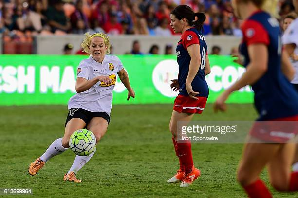 Flash forward Kristen Hamilton passes the ball in traffic during the 2016 NWSL Championship soccer match between WNY Flash and Washington Spirit at...