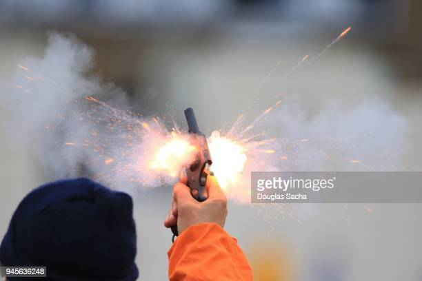 flash from a pistol being shot - judge sports official stock pictures, royalty-free photos & images