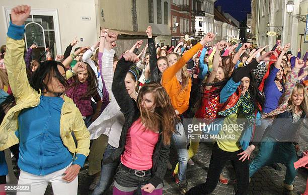 Flash Mob dancers perform on Pilies street in the Old Town of Vilnius late on April 19 2010 More than 700 flashdancers participated in the event AFP...