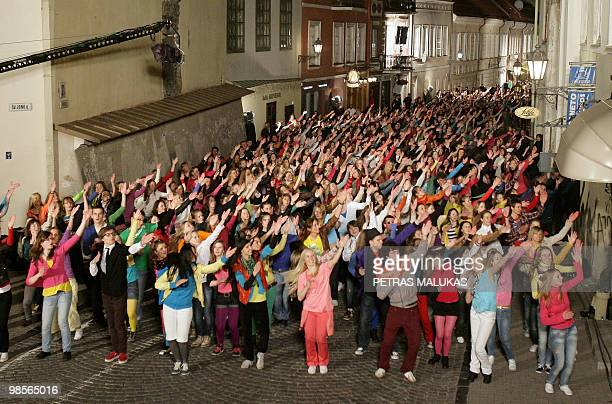 Flash Mob dancers perform on Pilies street in the Old Town of Vilnius late on April 19, 2010. More than 700 flash-dancers participated in the event....