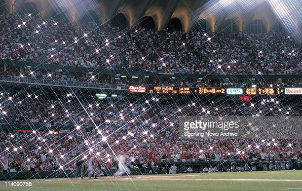Flashbulbs pop as fans watch Mark McGwire of the St Louis Cardinals hit his 62nd homerun on September 8 1998 at Busch Stadium in St Louis MO McGwire...
