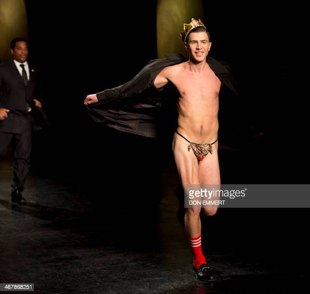 A flasher runs from security guards during a show of designs by Prabal Gurung during the MercedesBenz Fashion Week Fall/Winter 2014 shows ON February...