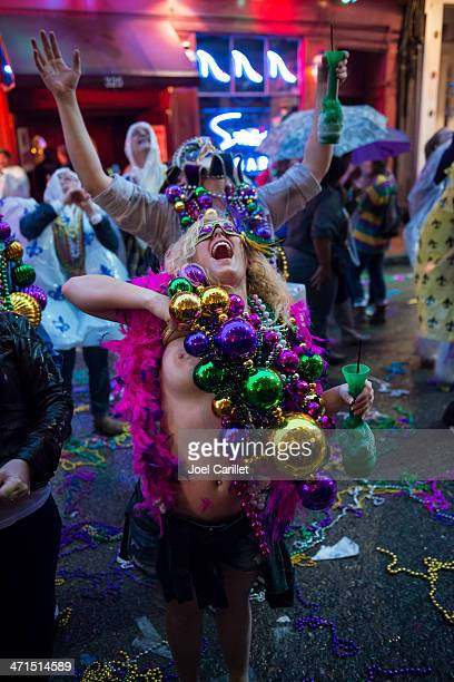 flashing breast for beads on bourbon street during mardi gras - mardi gras flashing stock photos and pictures