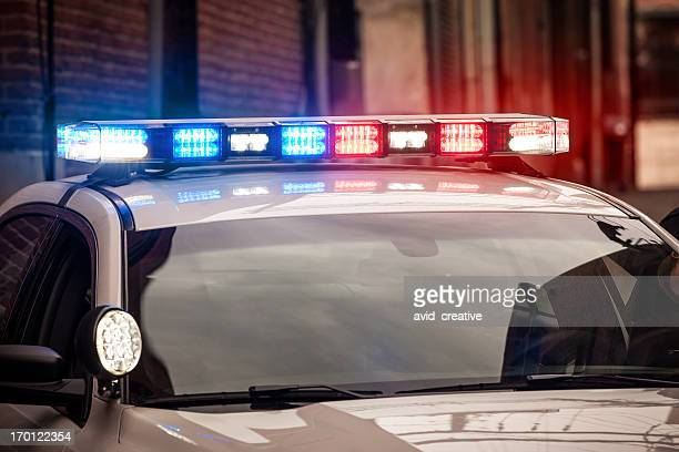 flashing lights on police car - lighting equipment stock pictures, royalty-free photos & images