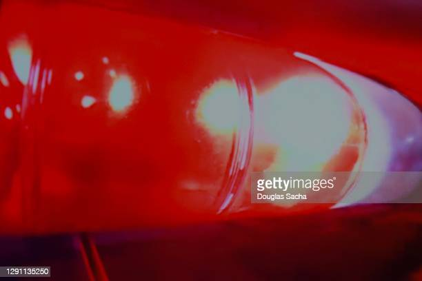 flashing police car lights - streaker stock pictures, royalty-free photos & images