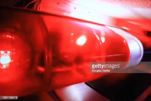 flashing red fire truck lights - streaker stock pictures, royalty-free photos & images