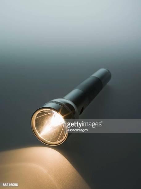 Flashlight shining light
