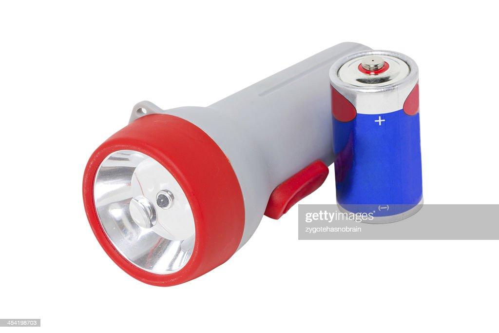 Flashlight with battery isolated on white. : Stock Photo
