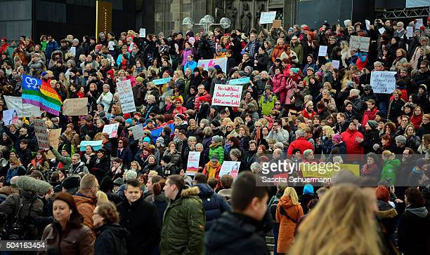 A flashmob gather in front of Cologne Cathedral next to Hauptbahnhof main railway station to protest against the New Year's Eve sex attacks on...