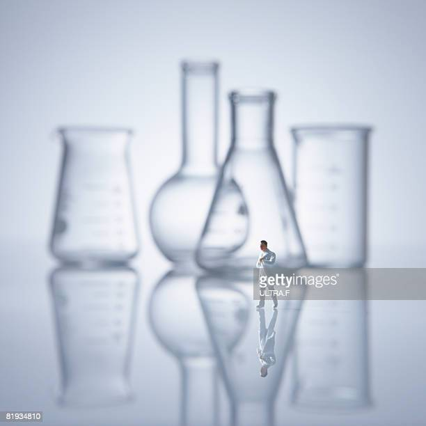 Flask, beaker, and researcher.