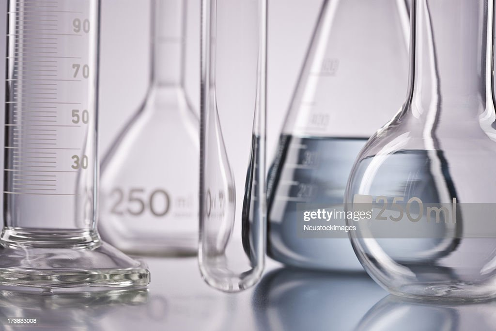 Flask with chemicals and test tubes over isolated background : Stock Photo