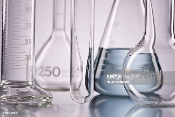 flask with chemicals and test tubes over isolated background - volume fluid capacity stock pictures, royalty-free photos & images