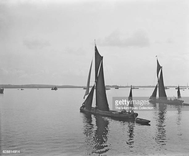 Flat bottomed Thames barges sailing at Sheeness on the northwest corner of the Isle of Sheppey in north Kent England april 1914