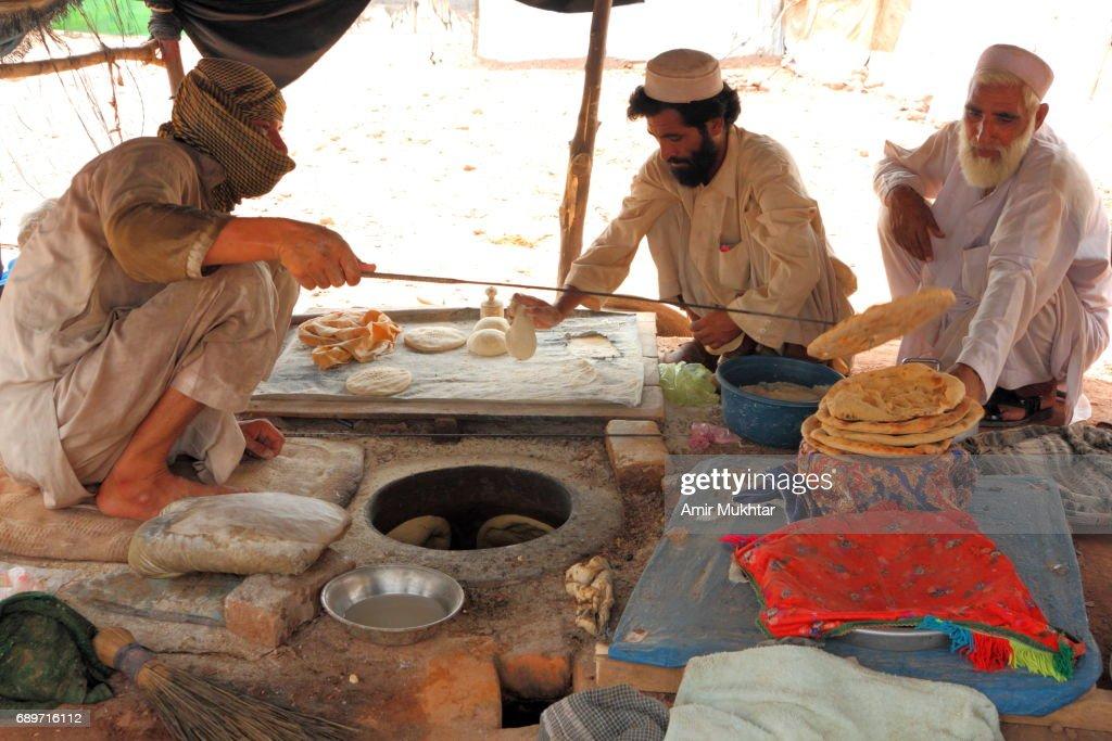Flat Bread Oven Baking Shop In Jalozai Flood Refugee Camp : Stock Photo