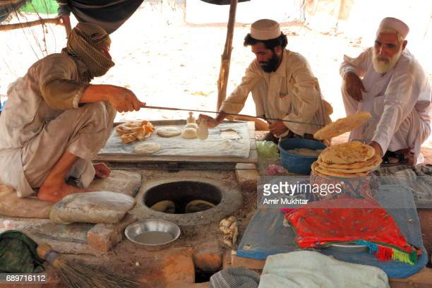 Flat Bread Oven Baking Shop In Jalozai Flood Refugee Camp