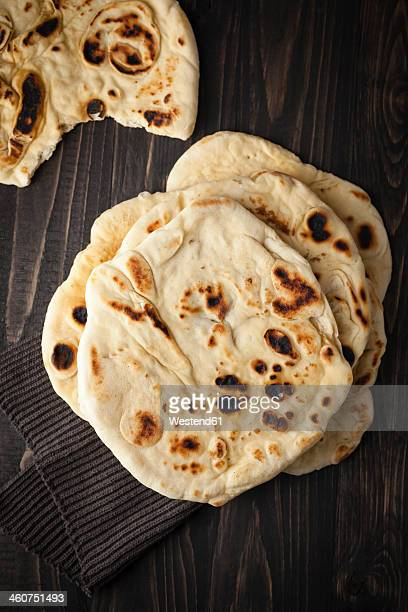 Flat breads on wooden table, close up