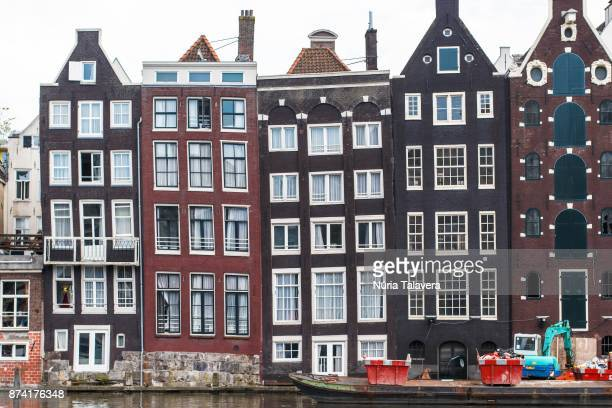 Flat buildings in front of a canal in Amsterdam