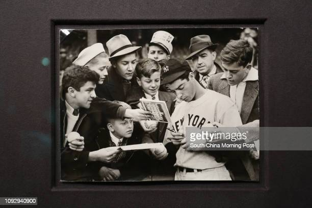 Flat copy of Stephen Wong's baseball collection photo of New York Yankees' Joe DiMaggio signing autograph for fans Photo taken in The Peak 03JUN17...