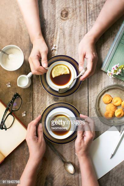 Flat lay afternoon tea time on rustic wooden table top.