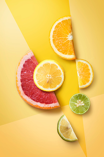 Flat lay assorted citrus fruits slice on graphical design background. - gettyimageskorea