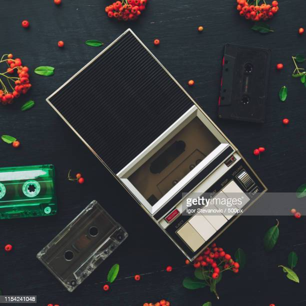 flat lay audio cassette and player, top view - recorder musical instrument stock photos and pictures