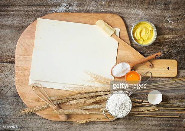 Flat lay bakery recipe card, utensils and ingredient on rustic wooden background.