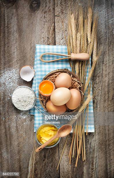 Flat lay bakery utensils and ingredient on rustic wooden background.
