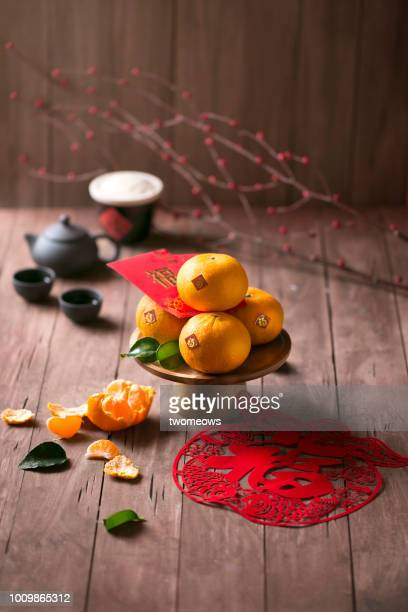 flat lay chinese new year food and drink still life. - chinese new year stock pictures, royalty-free photos & images