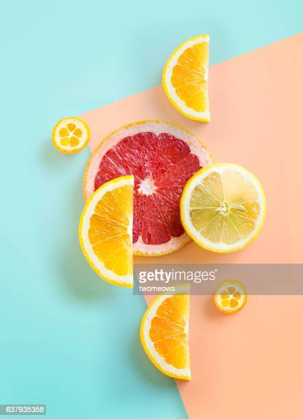 flat lay citrus fruits on graphical background. - citrus fruit stock pictures, royalty-free photos & images