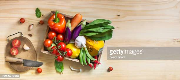 flat lay colourful uncooked vegan food still life. - leaf lettuce stock photos and pictures