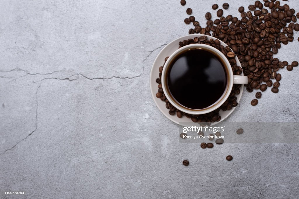 Flat lay composition cups of hot coffee and blanket on wooden background, space for text. Winter drink : Stock Photo