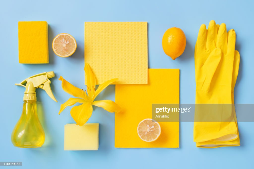 Flat lay composition with cleaning supplies, lemons and flower : Stock Photo
