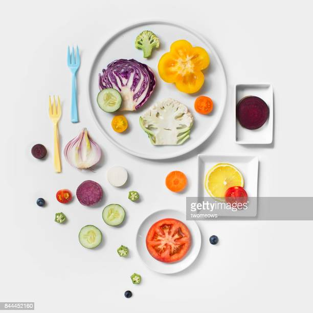 Flat lay conceptual vegan food on white background.