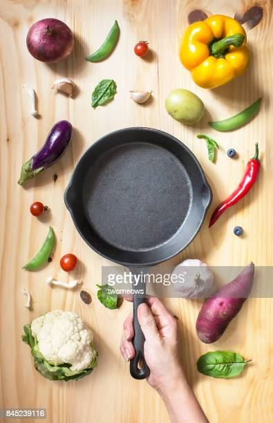 flat lay conceptual vegan food on wooden background. - cooking utensil stock photos and pictures