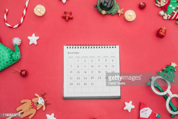 flat lay december calendar in red background - 2019 2020 calendar stock pictures, royalty-free photos & images