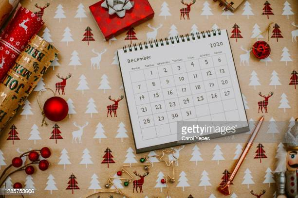 flat lay december calendar in rustic wood background - december stock pictures, royalty-free photos & images
