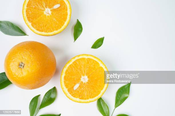 flat lay decoration of fresh orange slice fruits - orange stock pictures, royalty-free photos & images